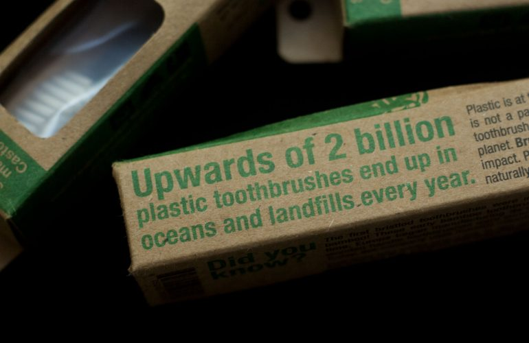 Brush With Bamboo cardboard packging with green writing on black background